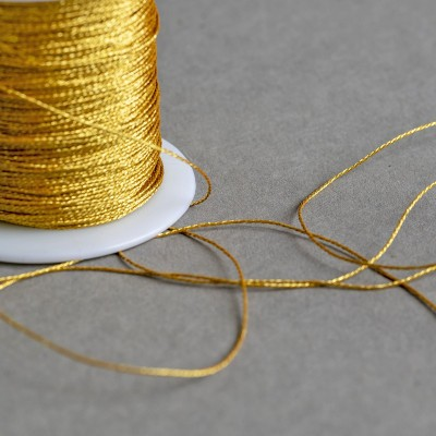 Нейлоновый шнур, золотистый металлик, толщина 0,5 мм