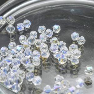 Бусина биконус стеклянная, прозрачный с отливом, 4 мм (...