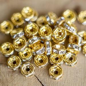 Разделитель со стразами, цв. золото, 4х2 мм...