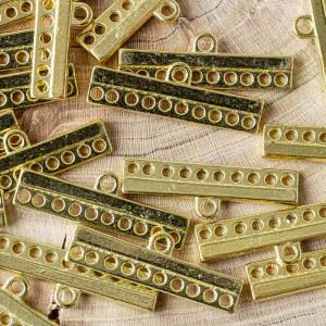Коннектор 1-10 отв, цв. золото, 9x28x2.5 мм...